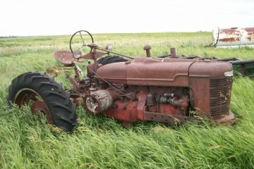 Rusty tractor in field
