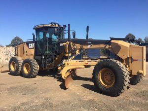 Full side shot Caterpillar 140M motor grader