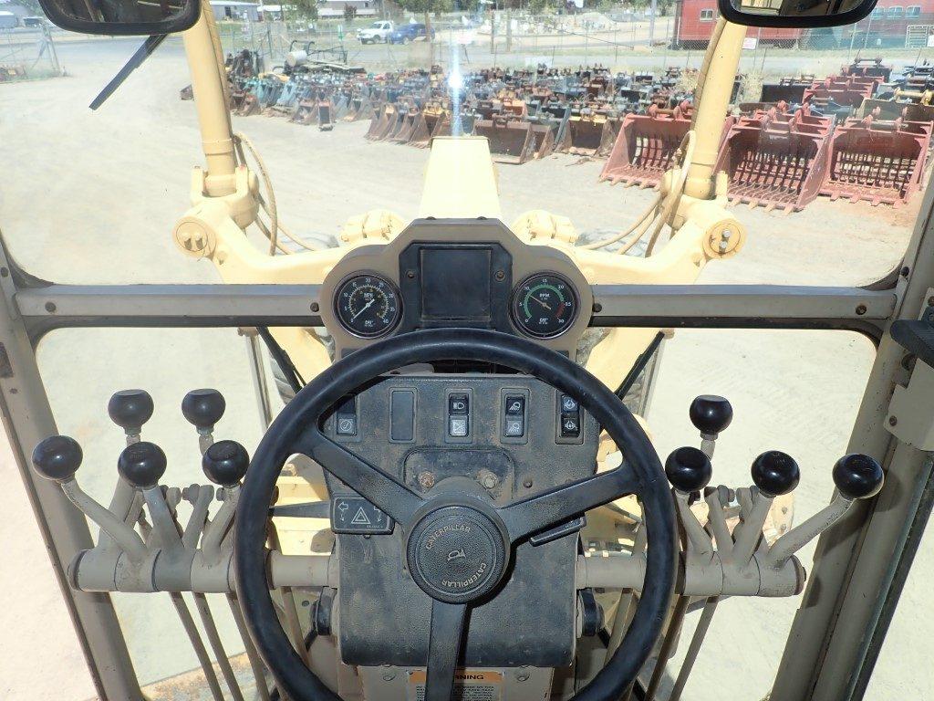 Cat 140h grader cab controls