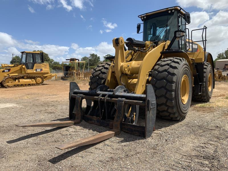 Caterpillar 966M with pallet fork attachment